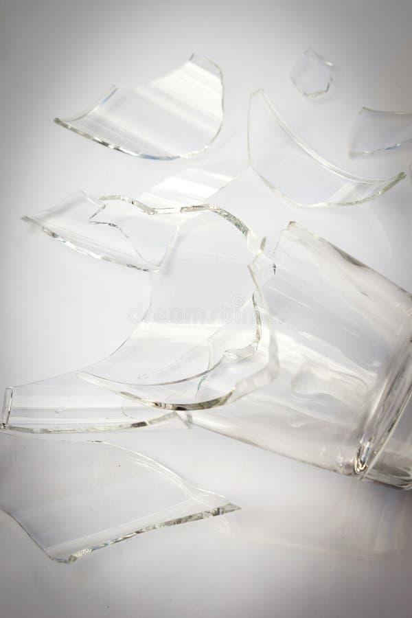 Broken glass on white background. With dark vignette royalty free stock photo