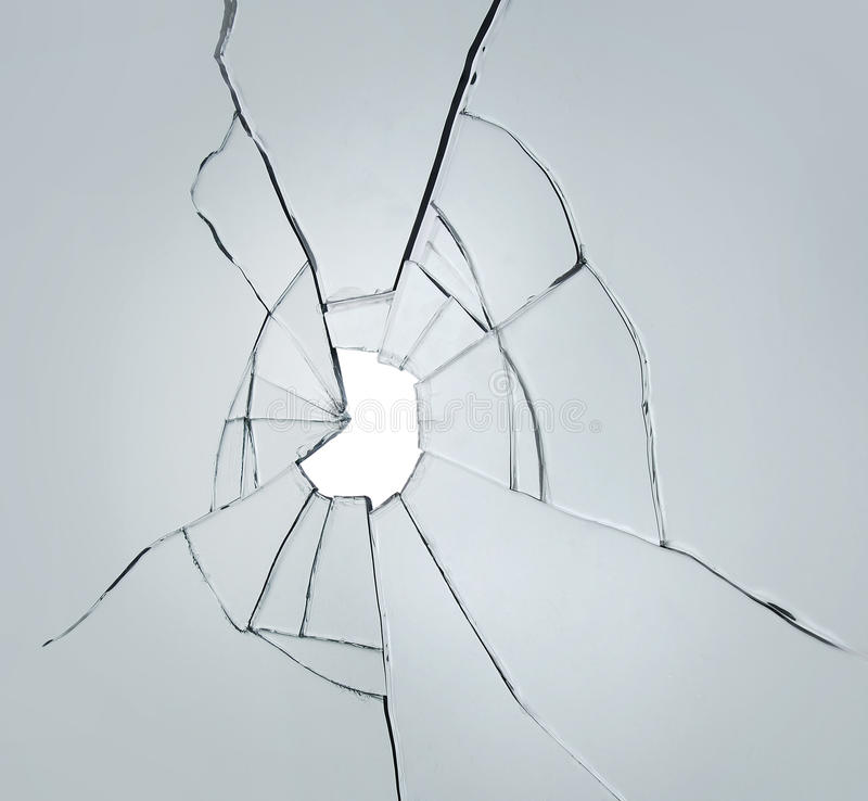 Broken glass on white background with hole royalty free stock image