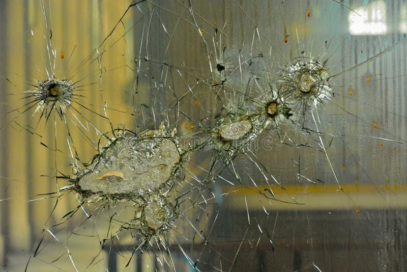 Broken glass window. Detail of a broken glass window royalty free stock photo
