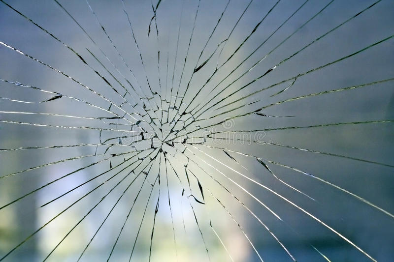 Broken glass on the window stock images
