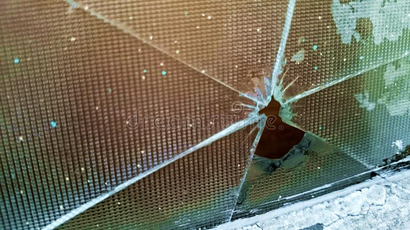 Broken glass window repair need. Break jalousie frosted windows breaking house dirty spotted hole break-in stock photography