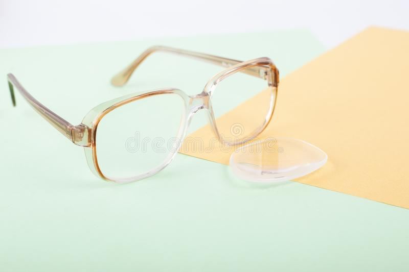 Broken glasses, lens replacement to improve vision, dropped glass from the frame of glasses stock images