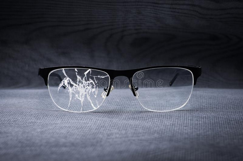 broken glasses on a metal background stock photo