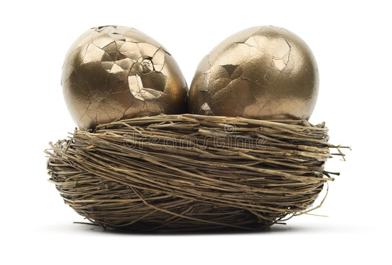 Cracked Gold Nest Eggs stock photos