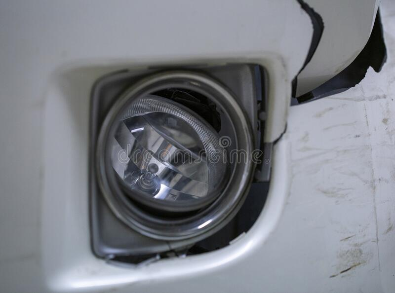 The broken headlight at the car stock images