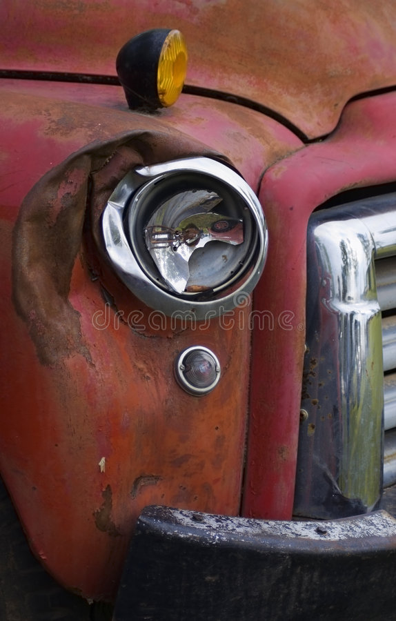 Free Broken Headlight On Old Red Truck Royalty Free Stock Photography - 1344497