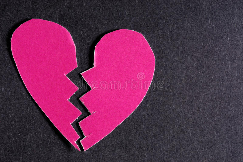 Broken heart. Broken real cut out of paper heart for your romantic or healthcare copy stock photography