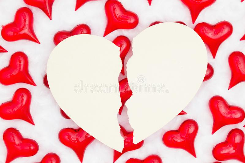 Broken heart card with red hearts on white fabric background royalty free stock photo
