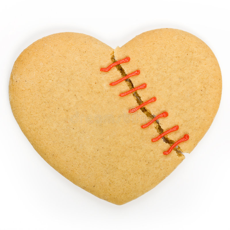 Broken heart cookie. Gingerbread cookie in the shape of a broken heart royalty free stock photography