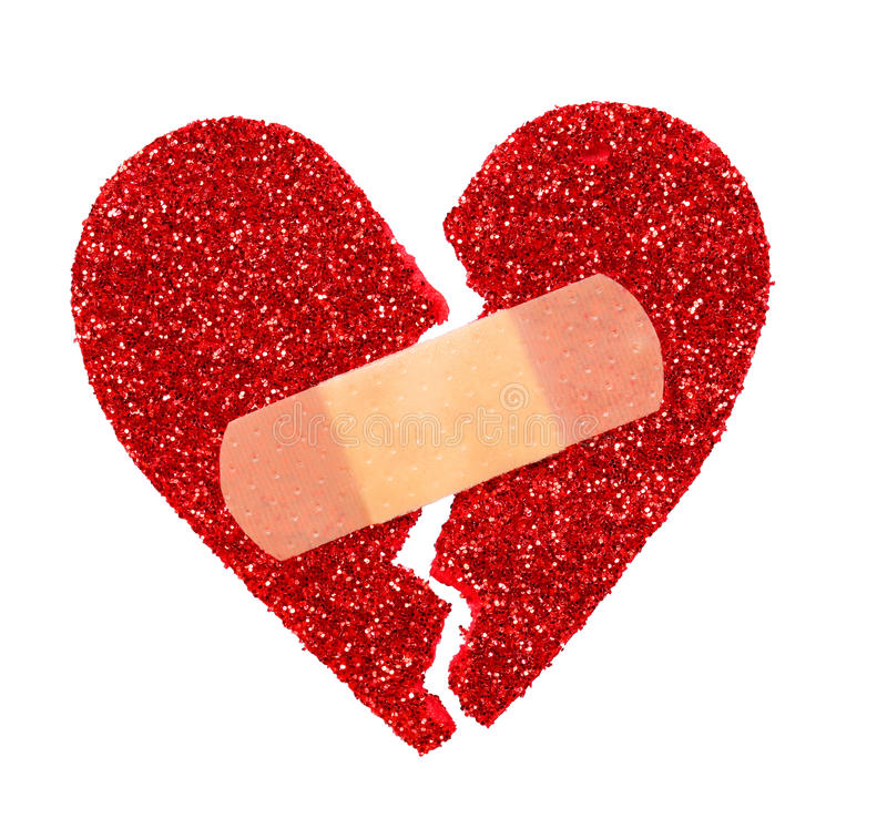Broken Heart. Glitter ripped heart fixed with adhesive bandage royalty free stock photography