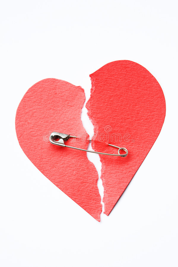 Broken heart joined with safety pin stock photos