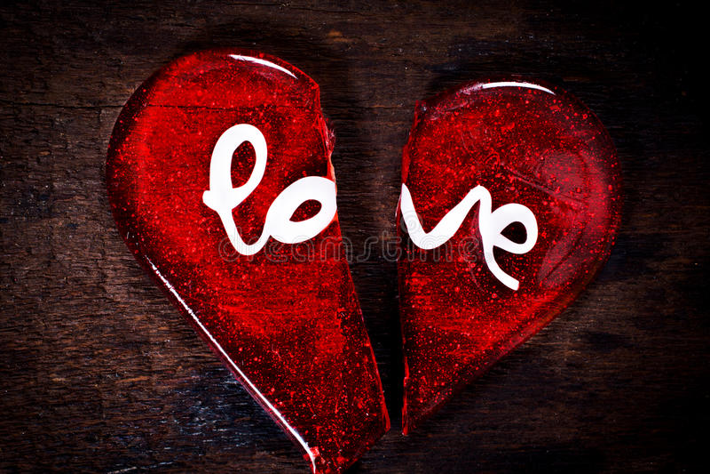 broken heart love sign wooden bacground 48562349