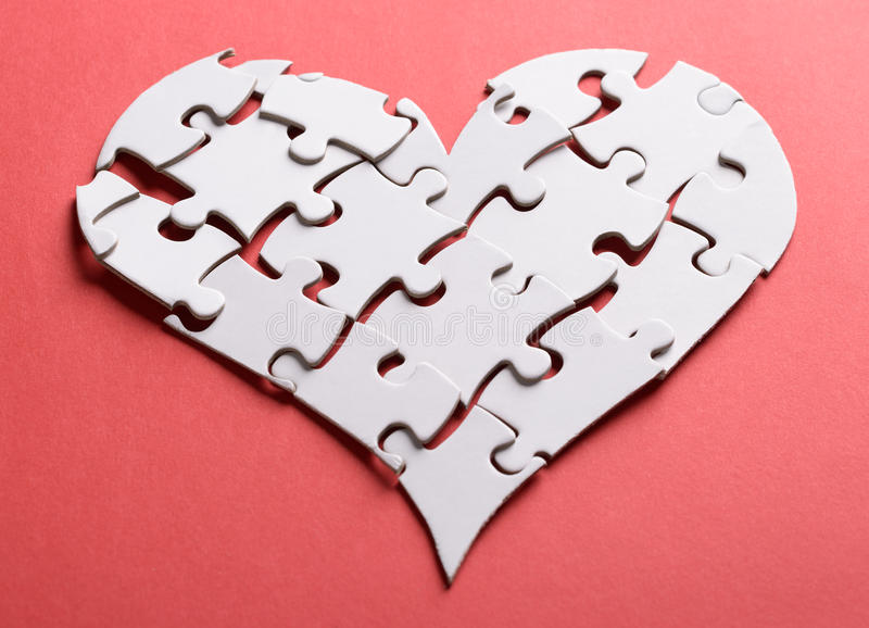 Broken heart made of puzzle stock photography