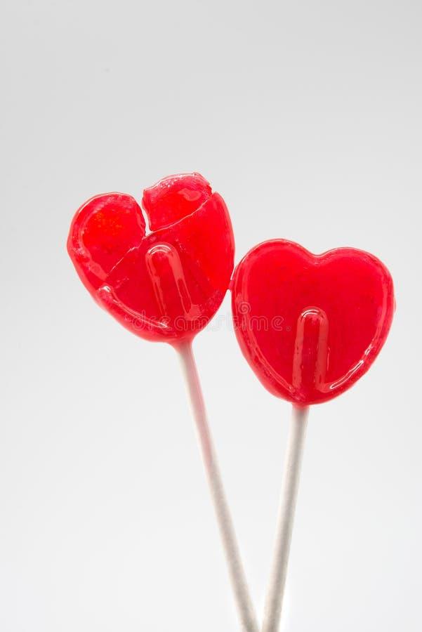 broken heart red heart-lollipop, sugar free royalty free stock photography