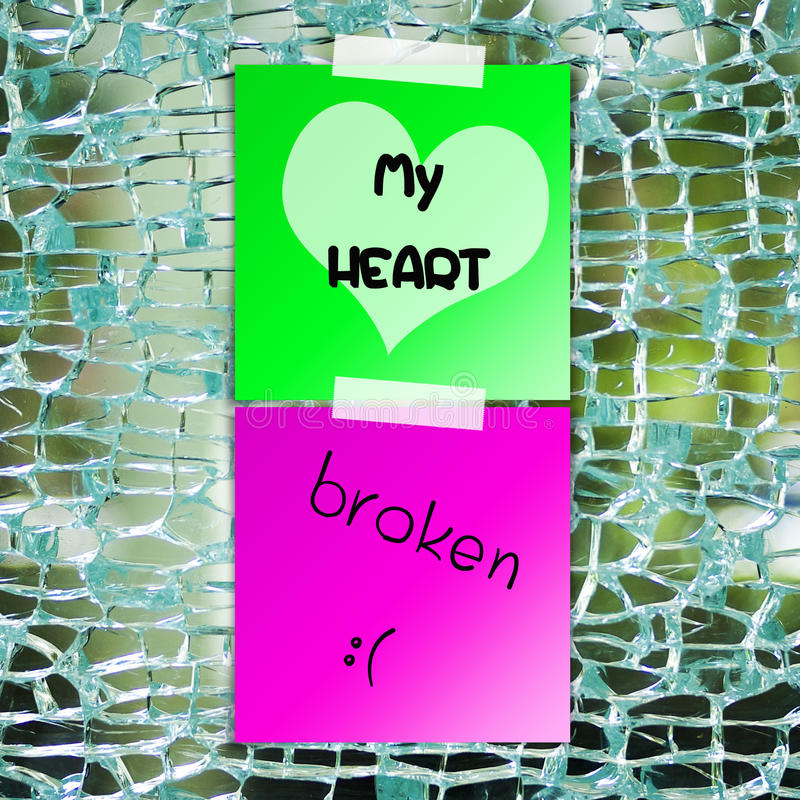 Broken heart text on sticky paper. With broken glass background stock photography