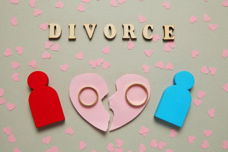 Broken heart and two gold rings. People couple divorce, love and conflict stock photography