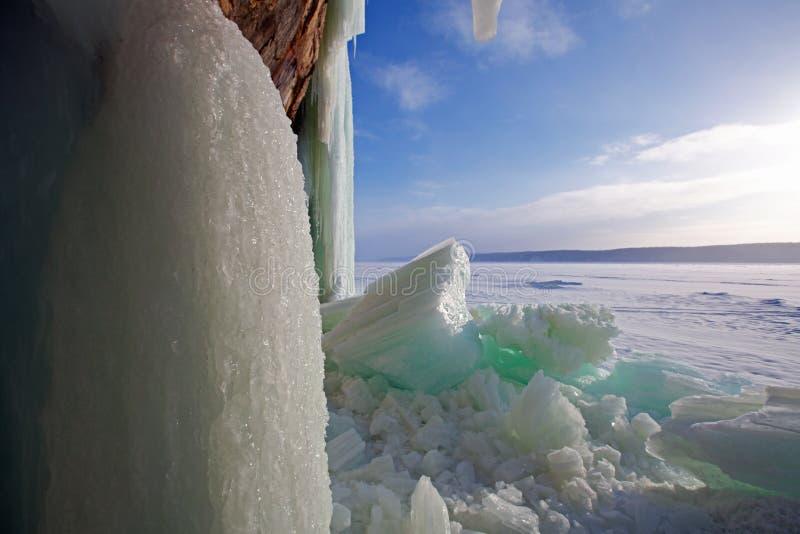 Broken Ice Curtains - Grand Island, Munising, Michigan. Huge chunks of broken ice curtains litter the ice at Grand Island in Munising Michigan. These enormous royalty free stock image
