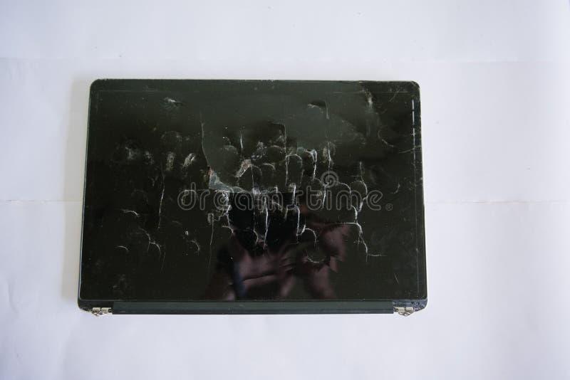Broken laptop screen on a light background royalty free stock photos