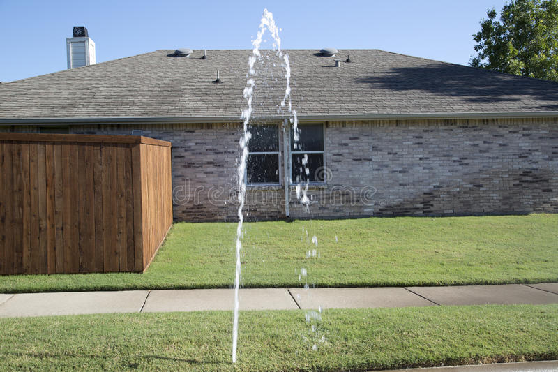 Broken lawn sprinkler. A broken lawn sprinkler in community royalty free stock photo