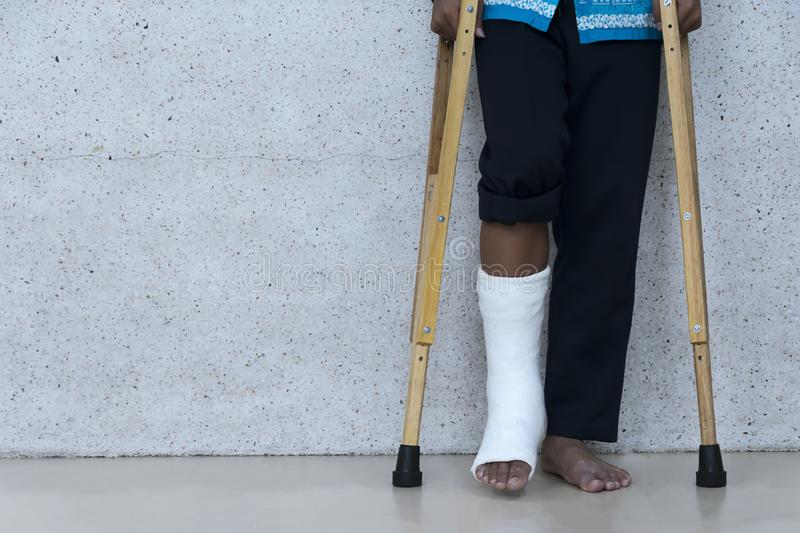 Broken legs and use Crutches as a support to walk. royalty free stock photo