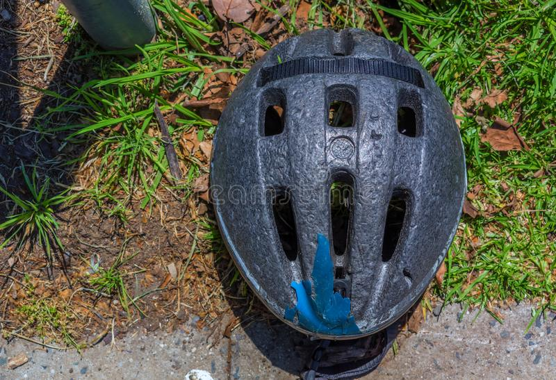 Broken old bicycle helmet royalty free stock image
