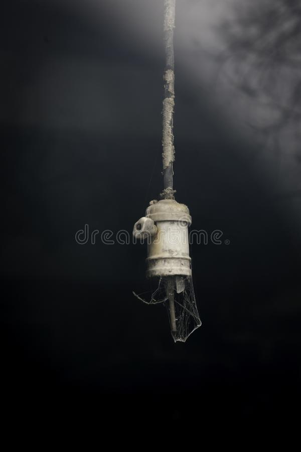 Old Broken Light Bulb in Abandoned Building stock photos