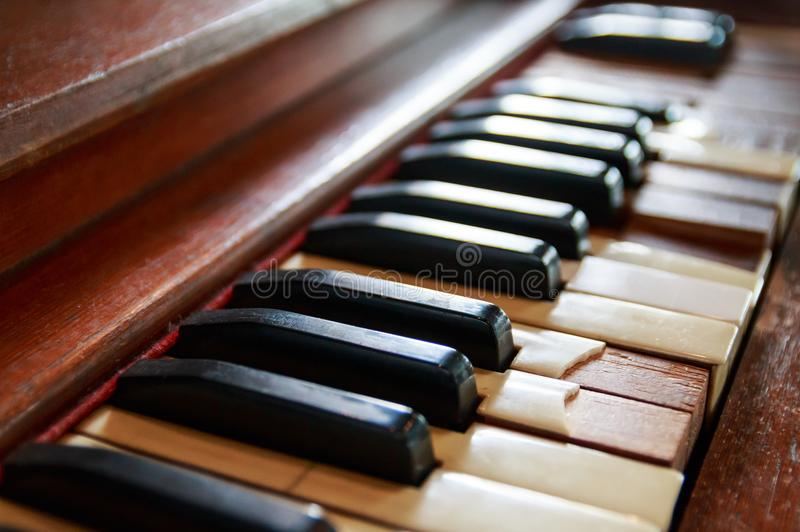 Broken old piano keyboard. For interior stock images
