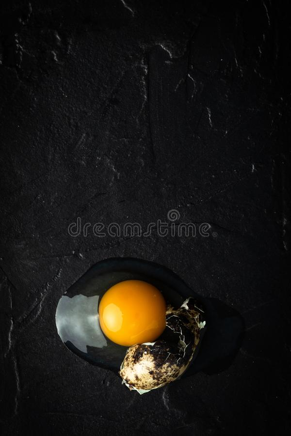 Broken Organic Quail Egg. Fresh Food Concept. Broken Organic Quail Egg. Fresh Healthy Food Concept royalty free stock photography