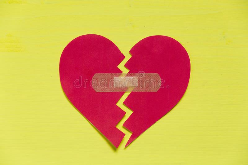 Broken paper heart with patch royalty free stock images