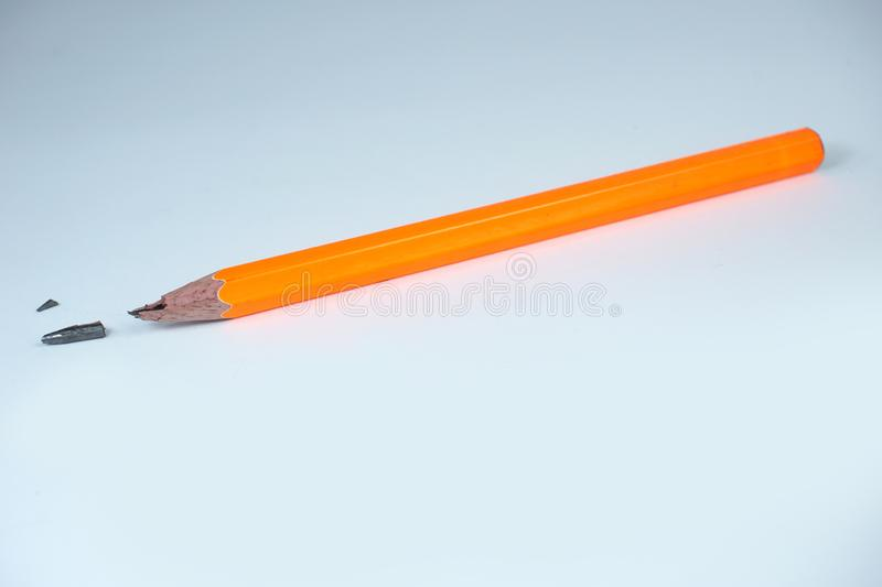Broken pencil on white background stock photography
