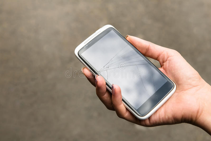 Broken phone in hand outdoors royalty free stock photo