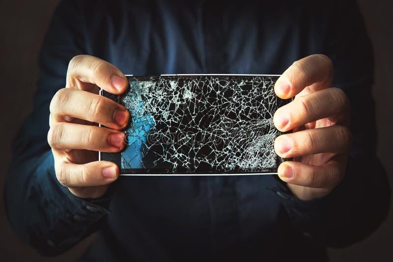 Broken phone screen in hand stock photos