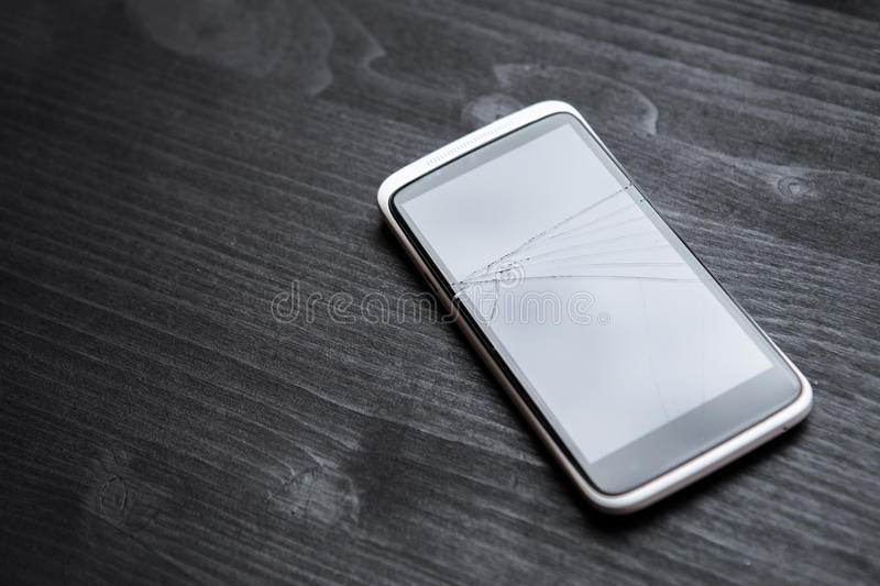 Broken phone on the table in office royalty free stock images