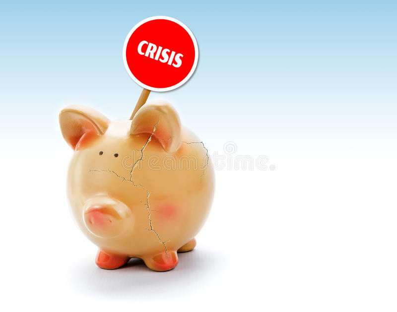 Broken piggy bank with cracks and Crisis tag. Conceptual stock images