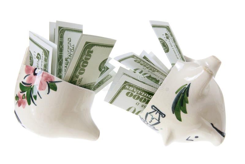 Broken Piggy Bank with Dollar Notes stock image