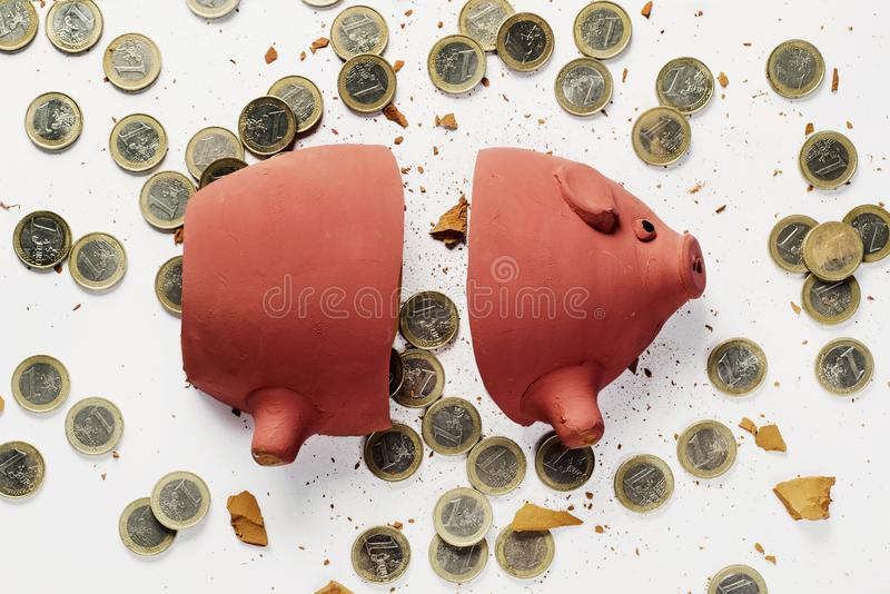 Broken piggy bank and euro coins stock images