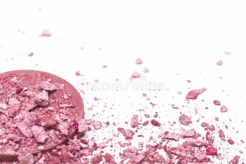 Broken pink blush on white background royalty free stock photo