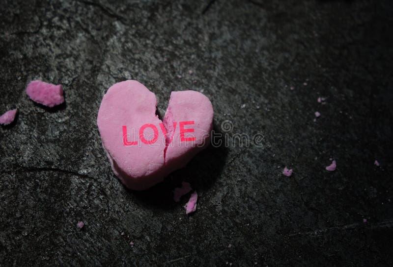 Broken pink love heart royalty free stock photo