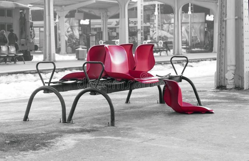 Broken plastic seats (selective color isolation) stock photos