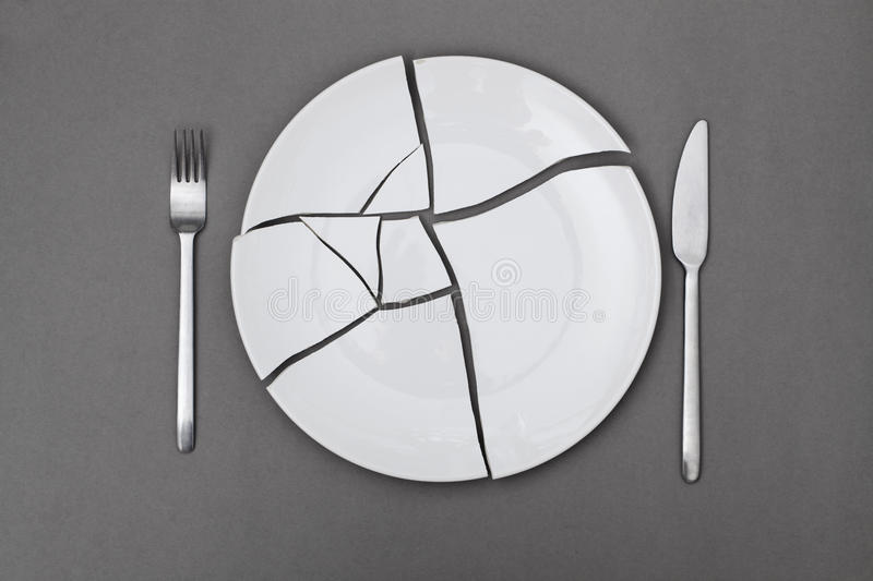Broken plate dieting. Broken plate for diet food background royalty free stock images