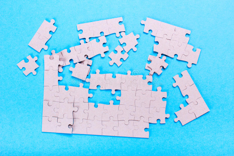 Broken puzzle pieces stock images