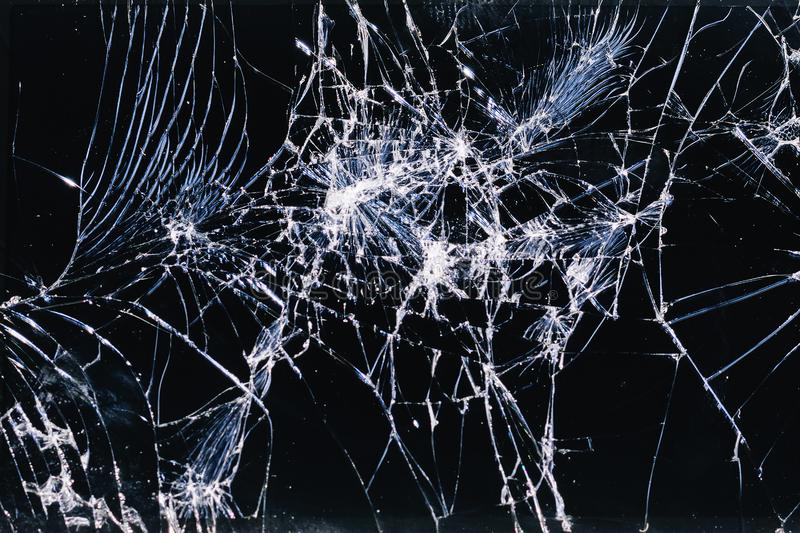 Broken and racked glass screen smartphone , white lines on black background,   design element, backdrop texture stock photos