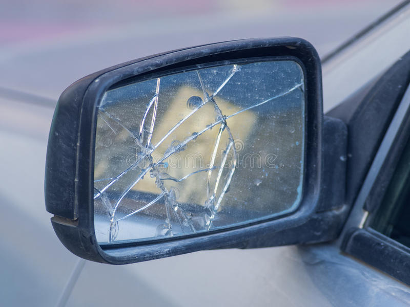 Broken rear view mirror in the car stock photography