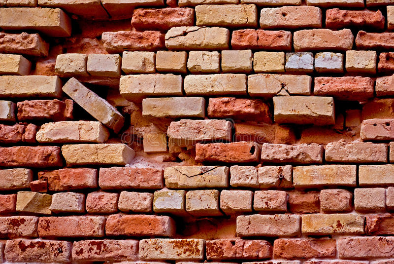 Broken red brick wall stock photos