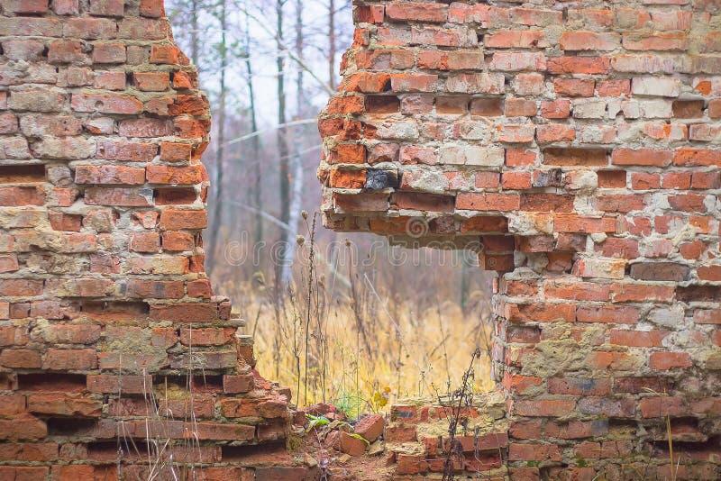 broken red brick wall stock image