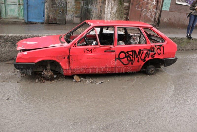 A broken red car stock image