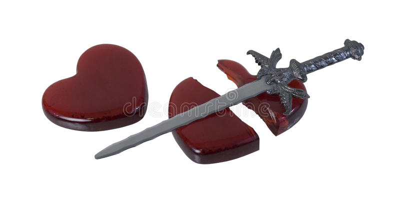 Broken Red Glass Heart with a Sword. Sword and a Broken Red glass heart symbolizing a broken heart over a failed romance - path included stock photo
