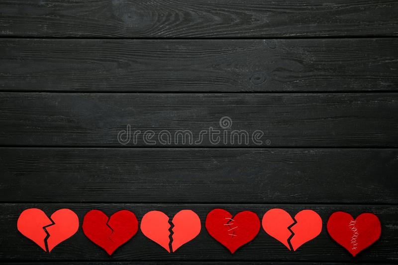 Broken red hearts stock photography