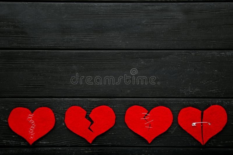 Broken red hearts stock photo