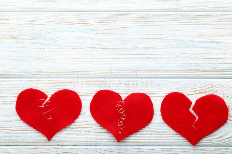 Broken red hearts stock images